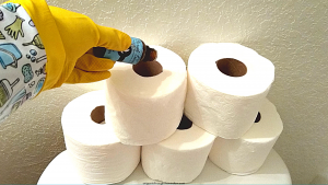 USE SCENTED OILS ON A ROLL OF TOILET PAPER TO DEODORIZE A SMELLY BATHROOM