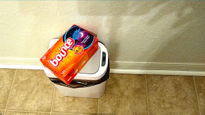USING DRYER SHEETS TO REMOVE BAD ODORS FROM BATHROOM TRASH CAN
